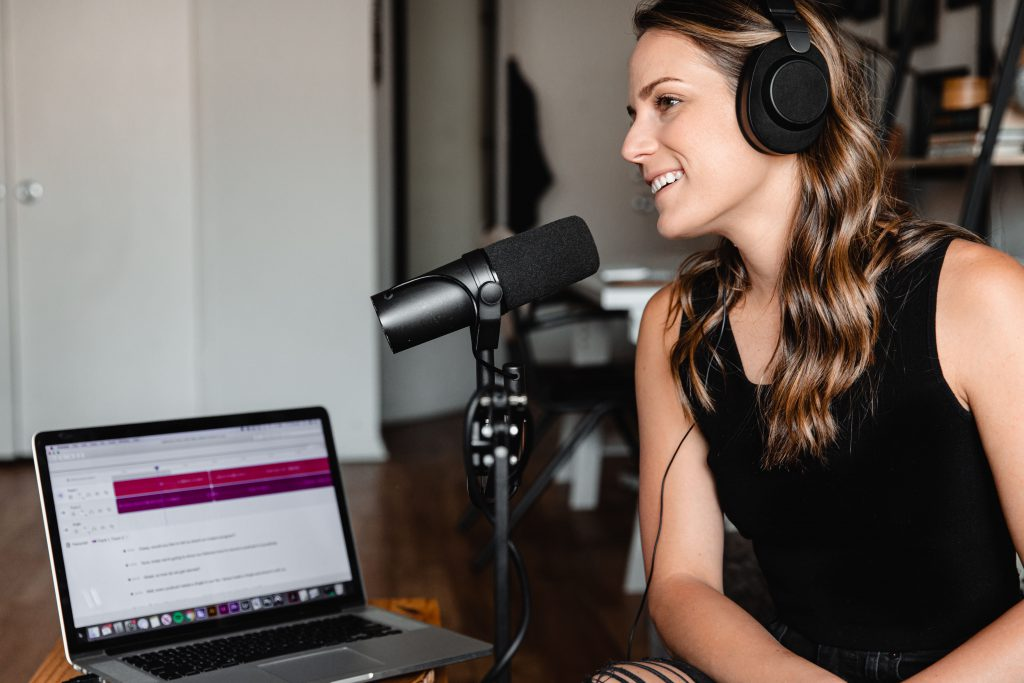 photo of woman doing a podcast