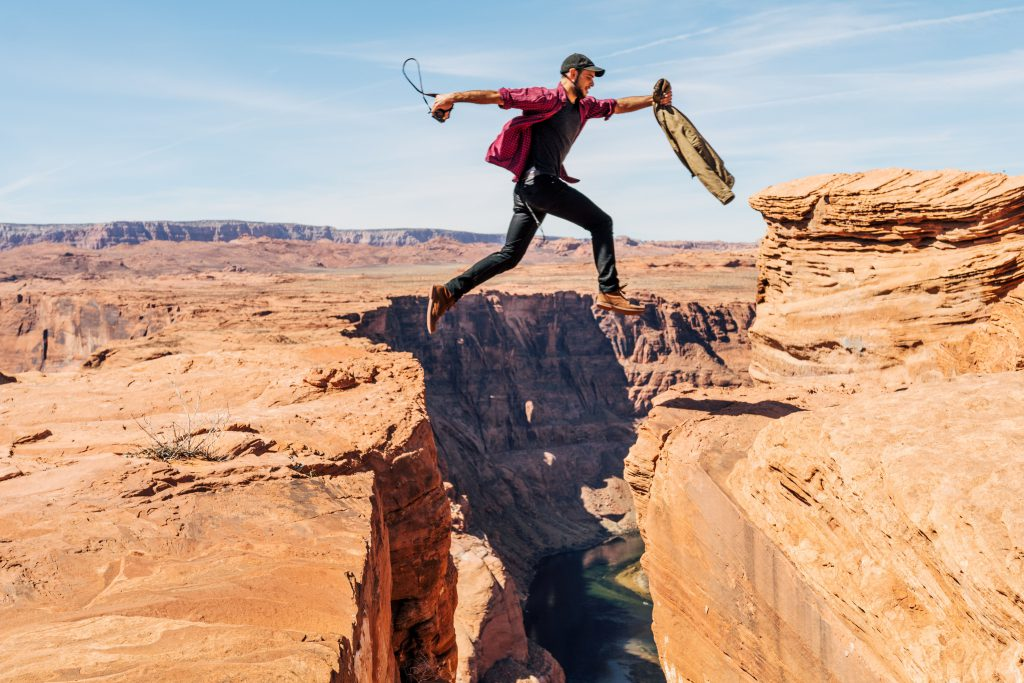 picture of man leaping across a chasm